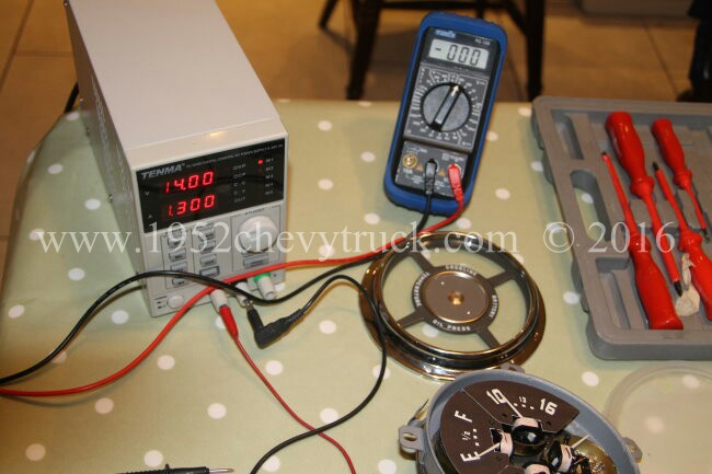 Bench power supply and meter.